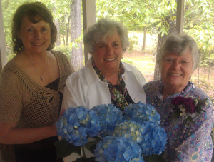 District V Director, Mary Lynda Crockett (center), Perry Garden Club President, Anne Miller, and Carolyn Coker, Perry Garden Club member at Carolyn's 80th birthday party.